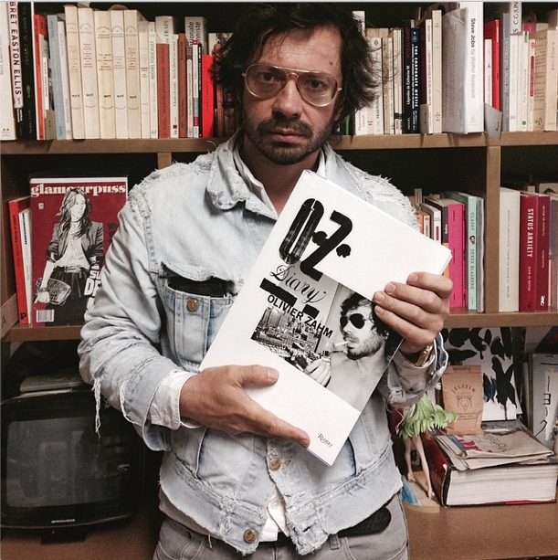 Olivier Zahm holding the first copy of his book in his own hands.